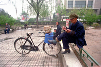 Grandson with grandmother and grandfather in  Beijing gardens.