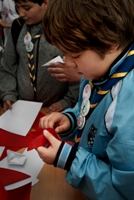 Boy Scout makes an origami crane