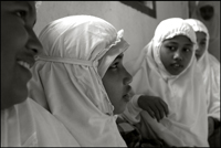 Girls prepare themselves for the midday prayer at an orphanage in Banda Aceh Indonesia
